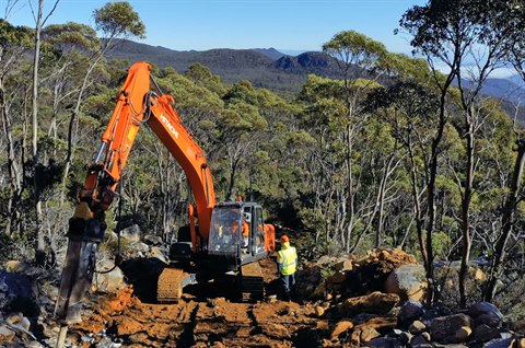 Photo of excavator in bushland