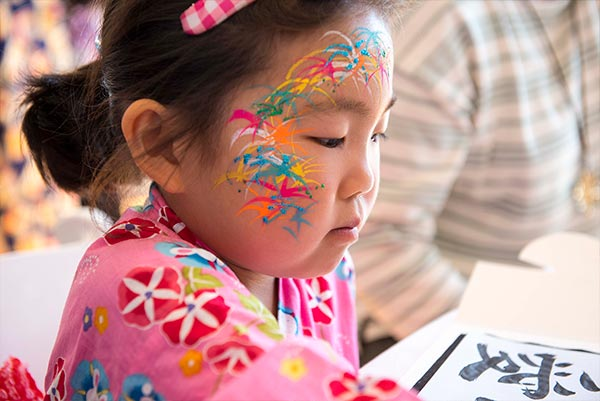 Japanese child wearing face paint