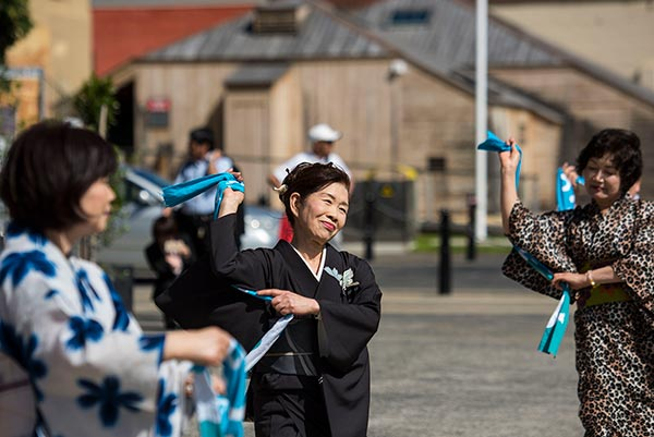 Japanese women dancing in traditional clothing